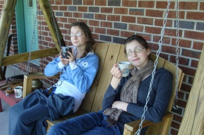 Marjorie and Emily sipping tea on the front porch swing