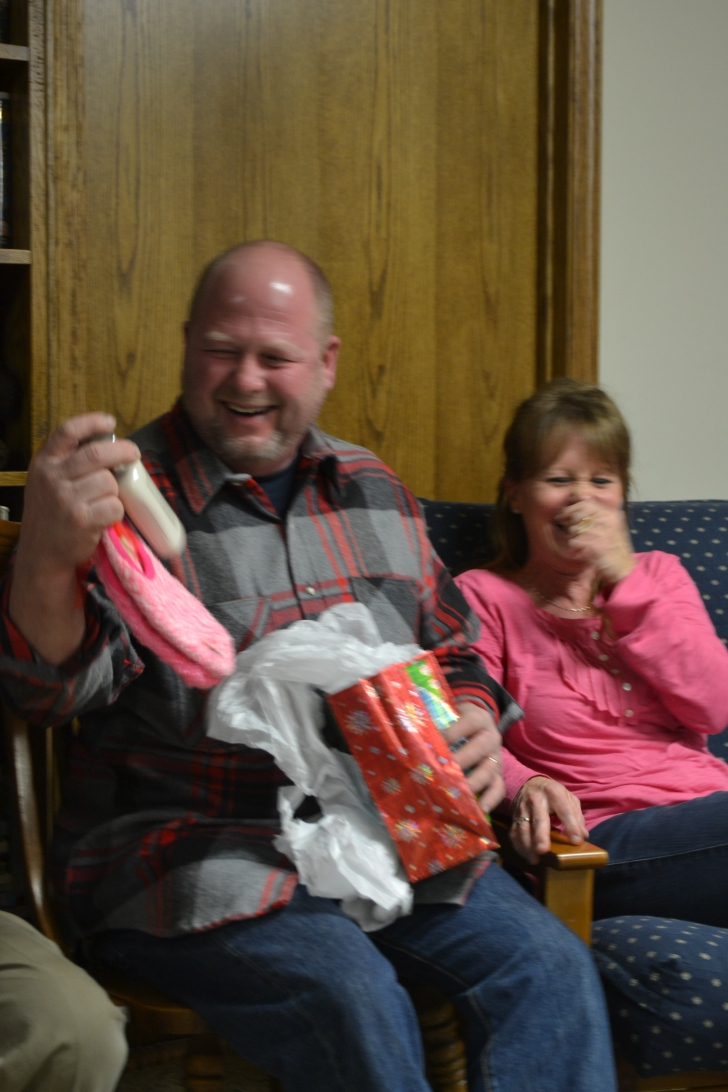 John gets during the Yankee Swap the pink fuzzy slippers and warm vanilla sugar lotion he's always wanted
